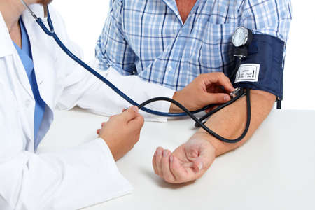 up: Doctor checking old man patient arterial blood pressure. Health care. Stock Photo