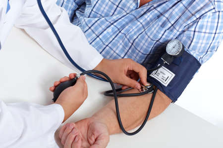 high up: Doctor checking old man patient arterial blood pressure. Health care. Stock Photo