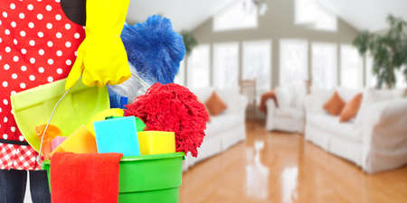 Domestic cleaning: Maid hands with cleaning tools. House cleaning service concept. Stock Photo