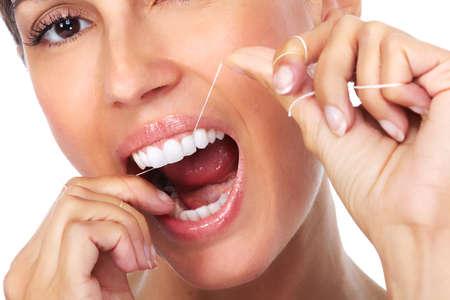 dental floss: Woman teeth with dental floss. Dentistry health care. Stock Photo