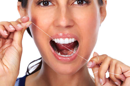 dental plaque: Woman teeth with dental floss. Dentistry health care. Stock Photo