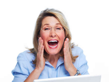lady hand: Happy senior woman with laptop computer isolated white background