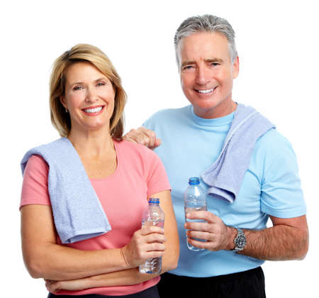 water bottles: Healthy fitness elderly couple. Sport and exercise concept.