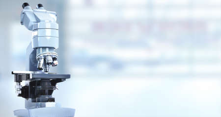 microscope: Scientific microscope in laboratory. Health care background.