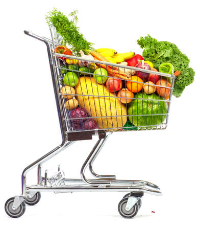 shopping trolleys: Grocery shopping cart with vegetables and fruits. Isolated on white.