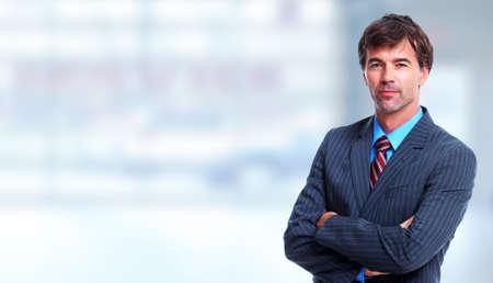 ejecutivos: Ejecutivo empresario sobre fondo azul oficina. Foto de archivo