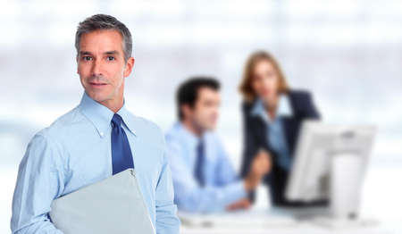 group  accountant: Handsome businessman over blue office banner background. Stock Photo