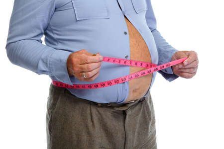 fats: Fat man belly with measuring tape. Lose weight concept.