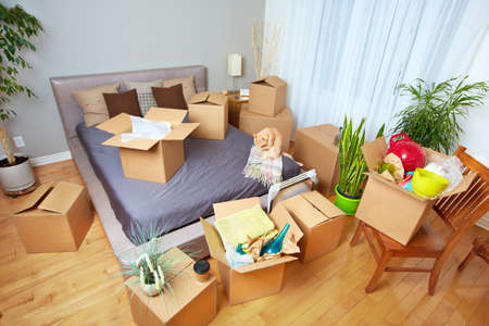 moving in: Moving boxes in new house. Real estate concept.