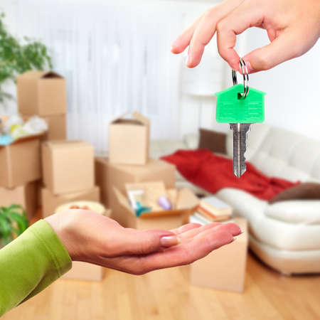 hand key: Hand with house key. Real estate and moving background.