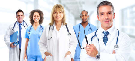 Group of medical doctors over hospital background. Health care.