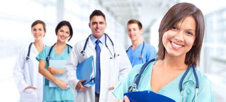 medical doctors: Group of medical doctors over hospital background. Health care.