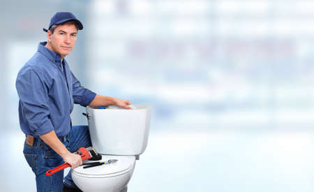commercial: Plumber repairing toilet. Plumbing and renovation banner.