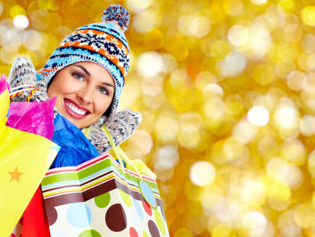 christmas shopping: Shopping woman with a bags over Xmas winter background. Stock Photo