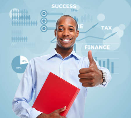 africanamerican: Young smiling African-american businessman over blue background.