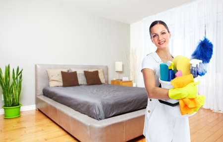 Domestic cleaning: Maid woman with tools. House cleaning service concept. Stock Photo