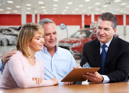 automobile dealers: Happy family near new car. Auto dealership and rental concept background.