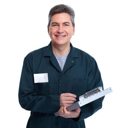 the clipboard: Hombre sonriente fontanero guapo. Fondo blanco aislado. Foto de archivo
