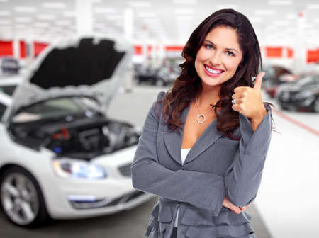 buying a car: Car dealer woman. Auto dealership and rental concept background.