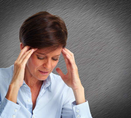 mental health problems: Tired business woman with headache migraine. Stress and health problems. Stock Photo