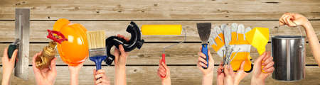house renovation: Hands of handyman with tools. House renovation and construction. Stock Photo
