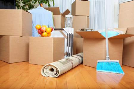 Moving boxes in new apartment. Real estate concept. Stock Photo