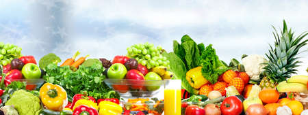 vegan: Fresh Vegetables and fruits over green background. Healthy diet. Stock Photo