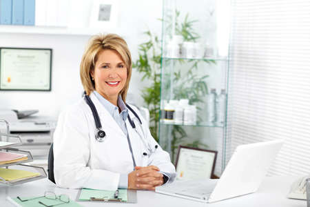 office uniform: Mature doctor woman in a clinical office. Health care concept.