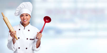 woman cooking: Beautiful Chef woman over blue banner background. Stock Photo