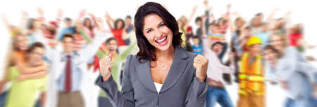 cheerful: Happy young business woman over people group background. Stock Photo