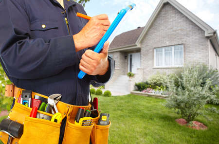 Handyman with a tool belt. House renovation service.  Stock Photo