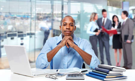 american media: African american businessman working in the office.
