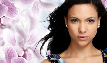 maquillage: Beautiful Asian woman face over floral background. Beauty and cosmetics.