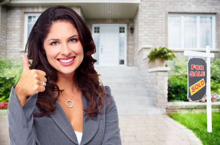 home for sale: Real Estate agent woman near new house. Home for sale concept.