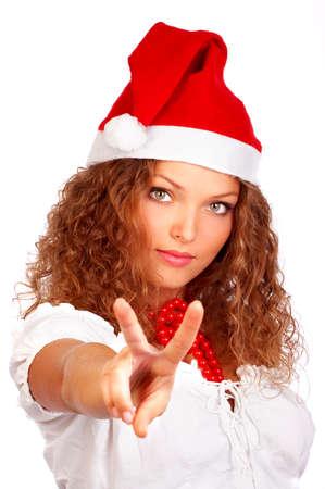 Mujer sonriente atractiva de Navidad en el casquillo de Santa Foto de archivo