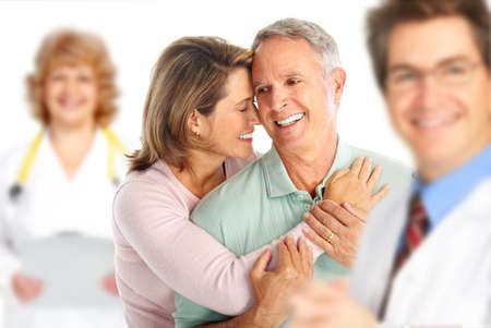 family doctor: Smiling medical doctor with stethoscope and elderly couple