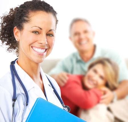 family doctor: Smiling medical doctor with stethoscope and elderly couple Stock Photo
