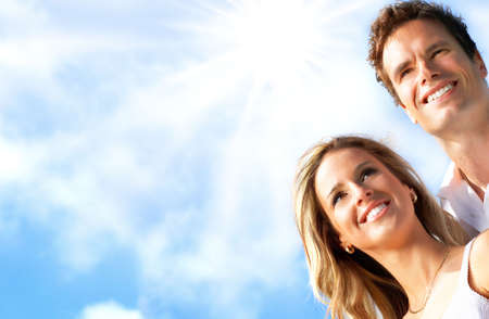 girl teeth: Young love couple smiling under blue sky