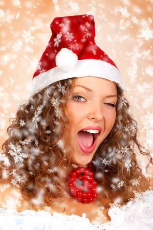 winking: Natale ammiccante donna in un Cap Santa.