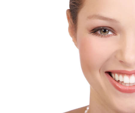tooth whitening: Beautiful young woman face. Over white background