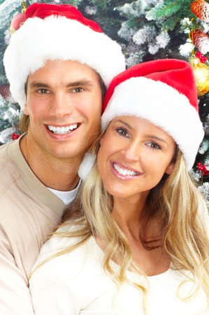 winter woman: Young happy couple near  a Christmas tree. Stock Photo