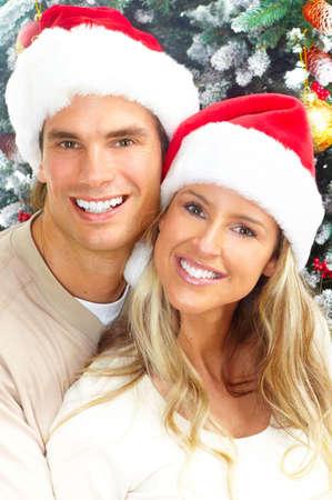 couple winter: Young happy couple near  a Christmas tree. Stock Photo