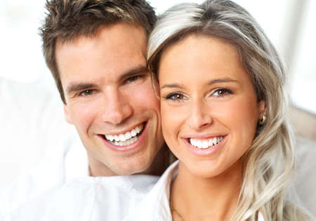 smiling teeth: Young love couple smiling at home Stock Photo