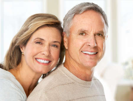 maturity: Happy smiling elderly couple at home