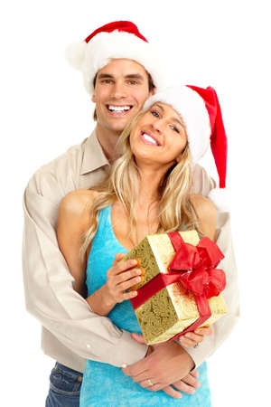 couple winter: Young happy couple near  a Christmas tree. Isolated over white background  Stock Photo