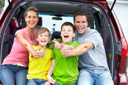 new motor vehicles: Smiling happy family and a family car