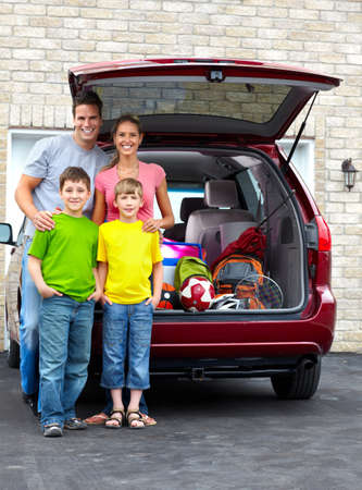 street child: Smiling happy family and a family car