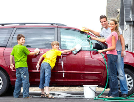 wash car: Smiling happy family washing the family car