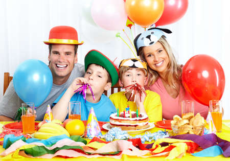 kids hugging: Happy family . Father, mother and children celebrating birthday at home Stock Photo