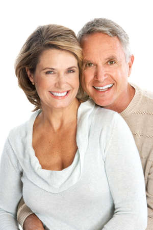 smiling teeth: Happy seniors couple in love. Isolated over white background  Stock Photo